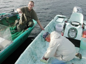 A creel clerk measures an angler's bass before returning it. (FWC photo)