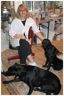 Teresa Cline and her two labs Tully is the male, 2 yrs and Madeleine (Maddy), female is 7 months.