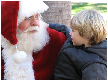 Four-year-old Eli Sincovich tells Santa that he has been a very good boy all year. Lori Ceier/Walton Outdoors