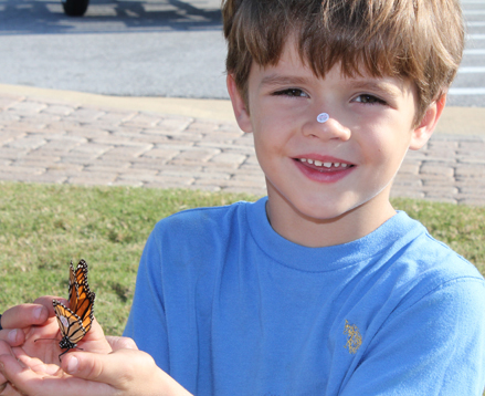 Max Burrough, 6, of Blue Water Bay sports a monarch tag on his nose along with tagging his first butterfly on Oct. 27, 2012. Lori Ceier/ Walton Outdoors