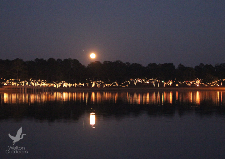 A full moon rises on Lake DeFuniak during the Christmas Reflections. Lori Ceier/Walton Outdoors