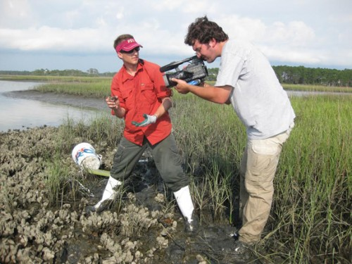Rob Dias de Villegas (right) filming Dr. David Kimbro on the first day of their NSF funded oyster study in 2010.  Photo courtesy Rob Dias de Villegas.