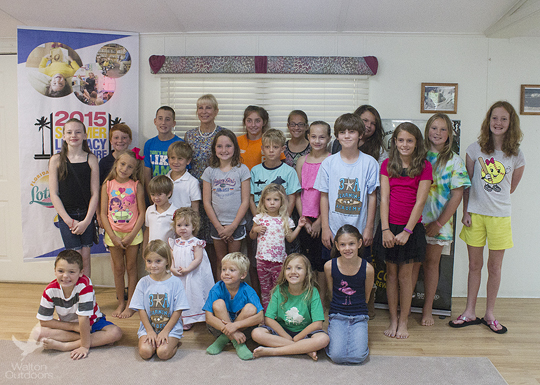 Children from the 30A Learning Academy, Coastal Branch Library summer reading program, and kids staying in the park posed for a photo with Florida First Lady. Lori Ceier/Walton Outdoors