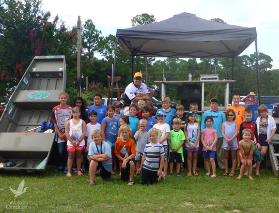 Catfish tournament entrants line up with the grand prize, a Jon boat with trolling motor. Lori Ceier/Walton Outdoors