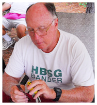 Fred Bassett, guest speaker, banding a hooded warbler bird. Photo courtesy Northwest Florida State College
