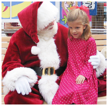 Syney Johns tells Santa she wants a doll with a yellow dress for Christmas. Santa arrived on a fire truck at Gulf Place Nov. 28.