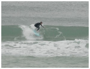 Bobby Johnson catches a wave near WaterColor. Photo courtesy William Chandler