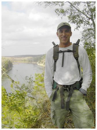 Brandan Babineaux atop a bluff overlooking the Apalachicola River. Photo courtesy Stacy Hamilton