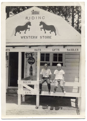 Locals Heather Marse and Jimm Ferguson in front of the Brand 'N Iron Western Store. Circa 1968