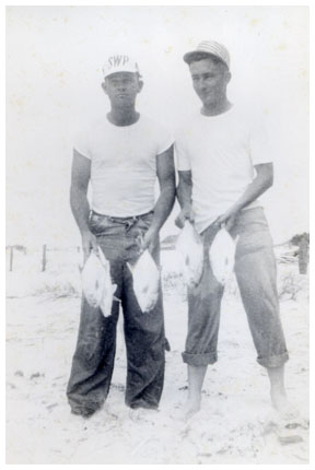 Gene Wesley and his friend Peck Carlton with their pompano catch.
