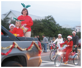 Locals dress up in holiday fashion for the South Walton Holiday Parade. Photo courtesy SeasideTimes.com.