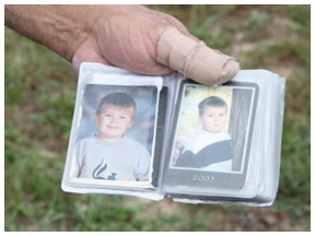 Robert Crawford holds a picture of his grandson, Benjamin Williams, who successfully underwent rabies shots.