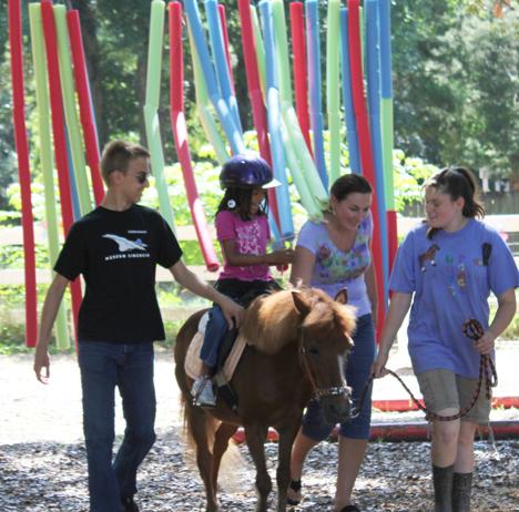 Nala Van Valen, on horseback, enjoys the noodle therapy at Grace Rides Niceville location. Lori Ceier/Walton Outdoors