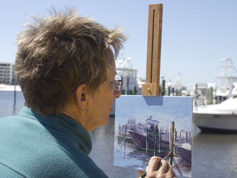Joan Vienot paints plein air along the Destin Harbor. Lori Ceier/Walton Outdoors