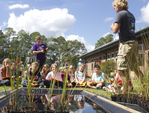 Americorps educator teaches students at Freeport Elementary School about the Choctawhatchee Basin Alliance Grasses in Classes program. Lori Ceier/Walton Outdoors