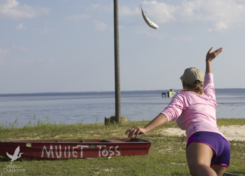 Emily Thurman tosses the winning mullet to break the second place tie. Lori Ceier/Walton Outdoors