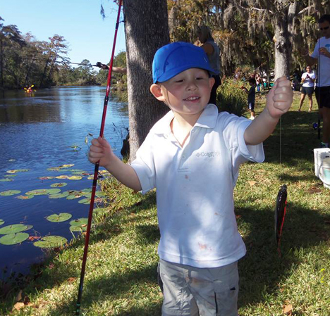Volunteer Carolyn Poole snapped this great photo of a young fisherman's first catch.