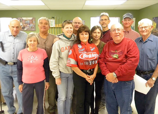 Professional lady angler Carolyn Poole (center) was the featured speaker at the Senior Fishing Club meeting. Photo courtesy J.B. Hillard