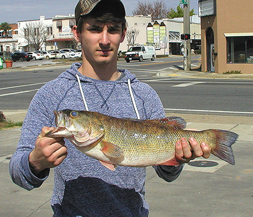 Tucker Martin, 17 with his record setting bass. Photo courtesy Chris Paxton, FWC.