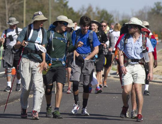 Alpha Tau Omega Walk Hard members trek along SR79 in Vernon on March 10, 2015 on their way from Troy AL. to Panama City Beach, FL. Lori Ceier/Walton Outdoors