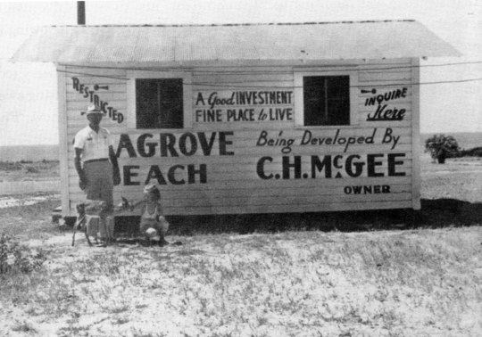 C.H. McGee, Sr., developer of Seagrove Beach, stands in front of his real estate office with pet deer, Bambi, and little Margaret Pridgen. His office was on the corner of CR395 and CR30A. Circa 1950. Photo credit Cube McGee