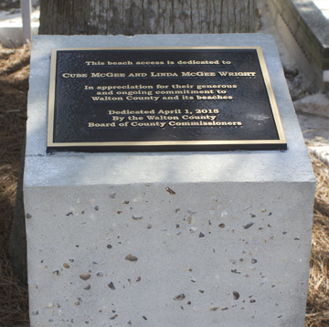 A plaque commemorates Linda McGee Wright and Cube McGee at the Live Oak beach access.