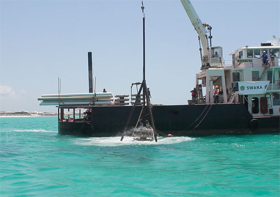 Reef structure being lowered into the Gulf. Lori Ceier/Walton Outdoors