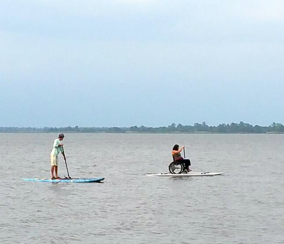 Allison Harasin exploring the Choctawhatchee Bay on her inaugural ability board journey. Outriggers keep the board stable. Photo courtesy Walt Hartley