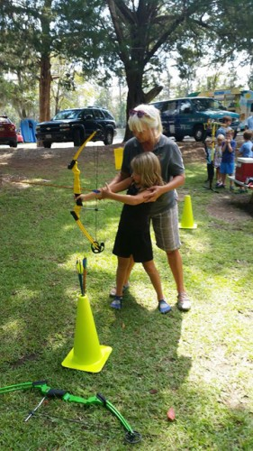 Jackie Roe experiencing archery with Dana Weiler from Freeport Parks and Recreation. Photo courtesy Steve Roe
