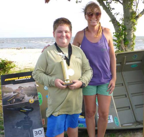 Brandy Foley (R) of Choctawhatchee Basin Alliance is standing with Dalton Taylor, the grand prize winner of a new Tracker Marine Jon Boat and trolling motor.